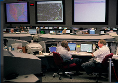 Command Center staff manage the flow of air traffic when weather, equipment, runway closures, or other conditions are expected to place stress on the NAS.